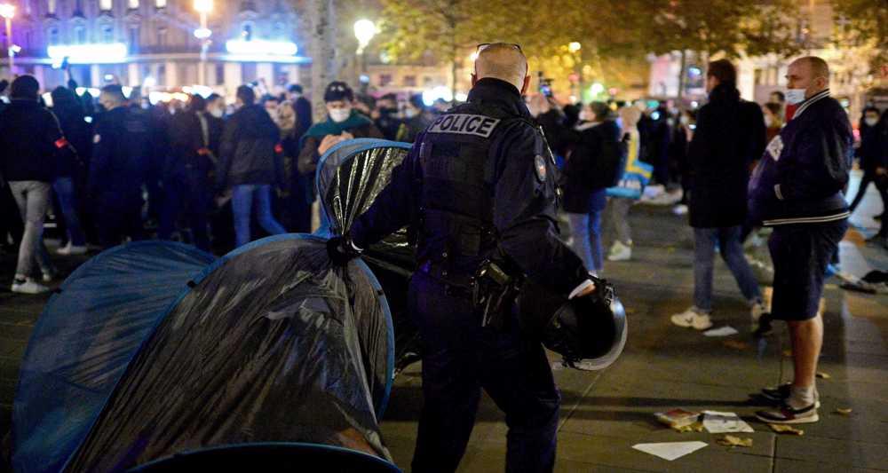 France to probe Paris refugee camp dismantling after 'shocking' clashes