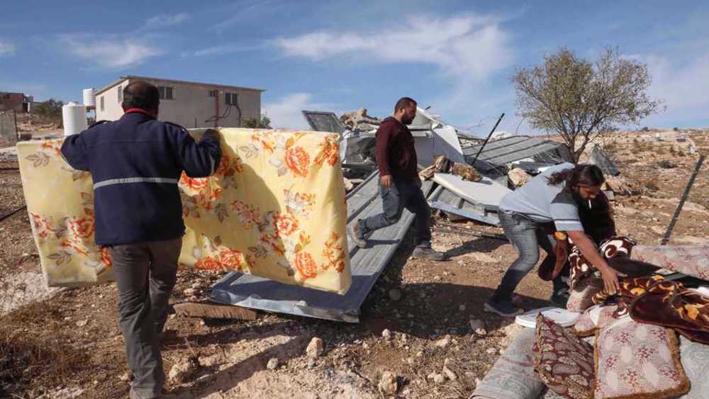 Israel forces Palestinian brothers to demolish own home in occupied West Bank amid arrests
