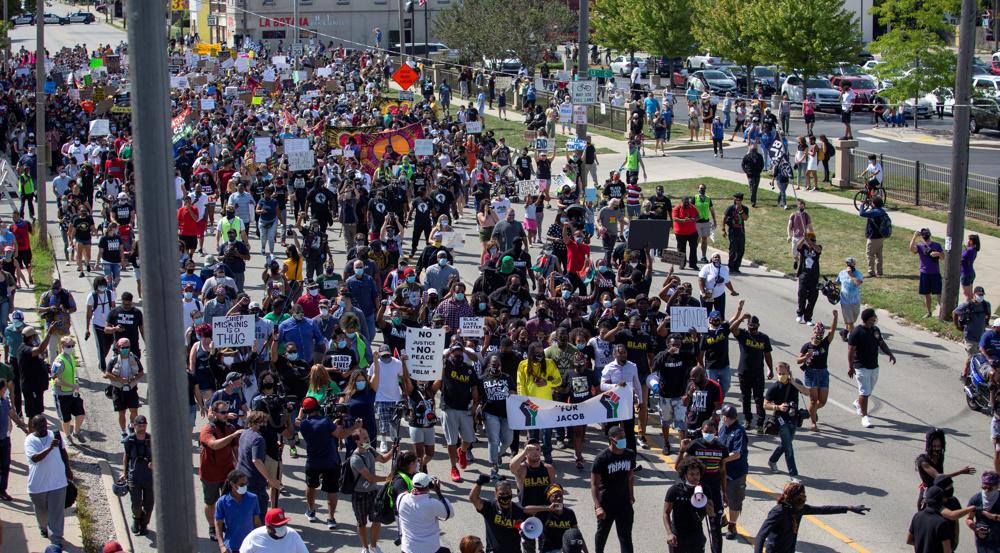 Trump defends Kenosha killer as hundreds of US protesters arrested