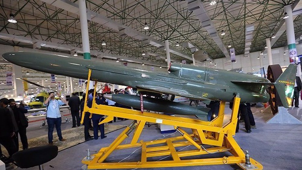 Iran military drone chases away intruding US spy, combat planes