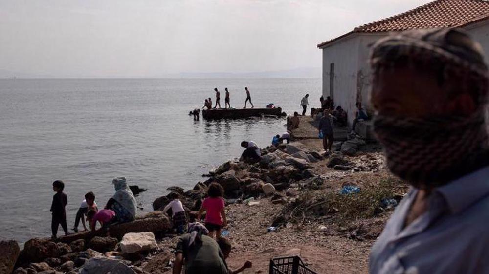 Greek police arrest 5 refugees over fire at camp