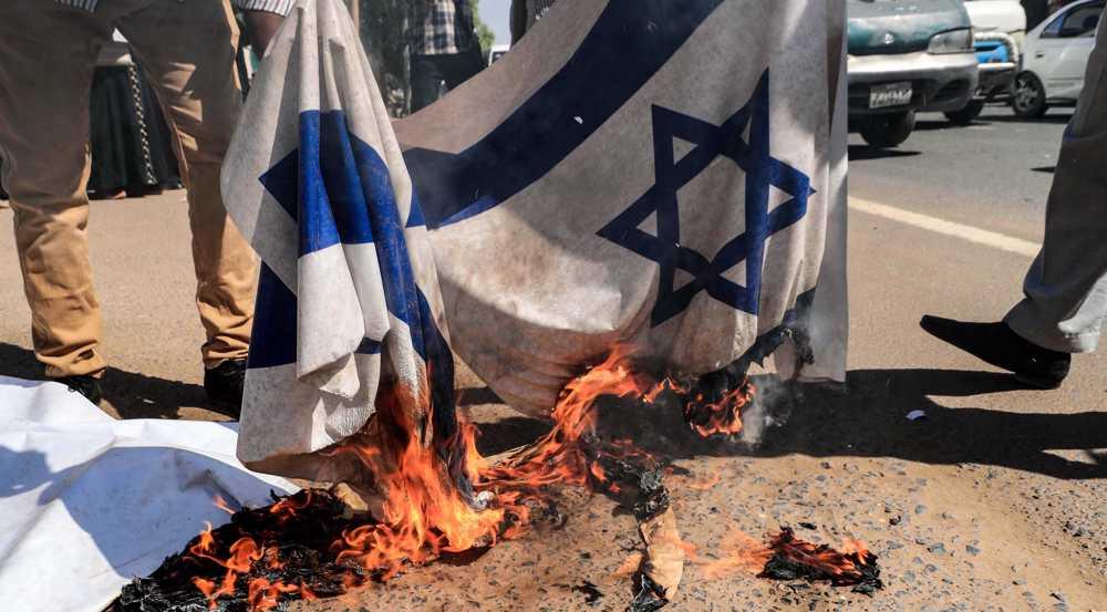Sudan protesters burn Israeli flag, slam normalization deal