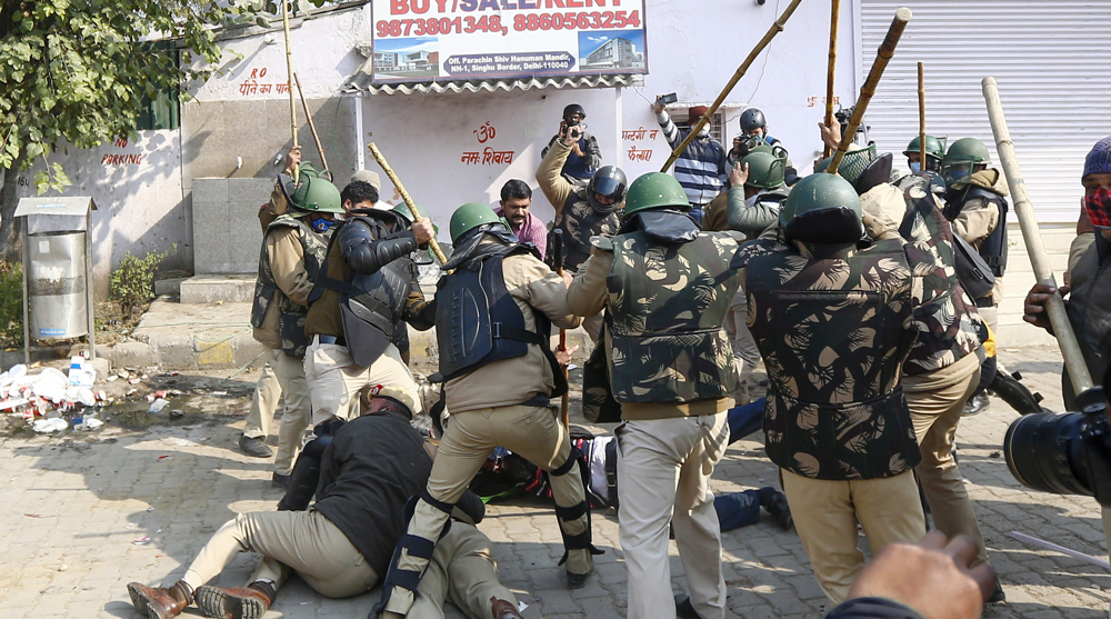 Clashes erupt at farmers protests site in New Delhi