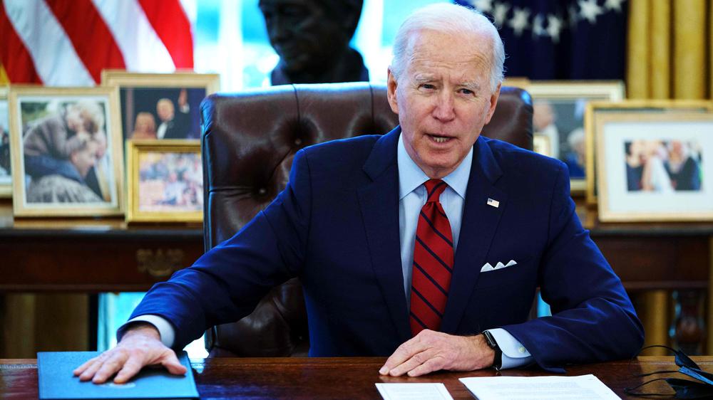 Biden signs bill raising US debt limit, averting default