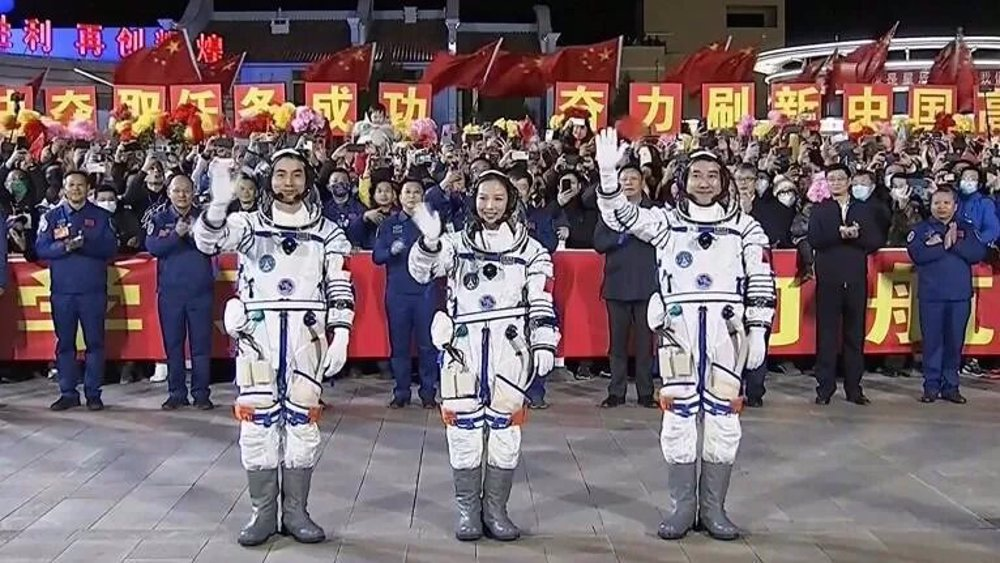Chinese crew successfully dock with space station: State media