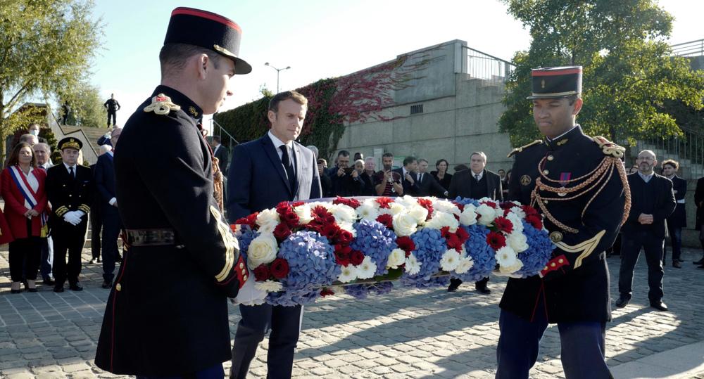 Without apology, Macron decries 'inexcusable' massacre of Algerians