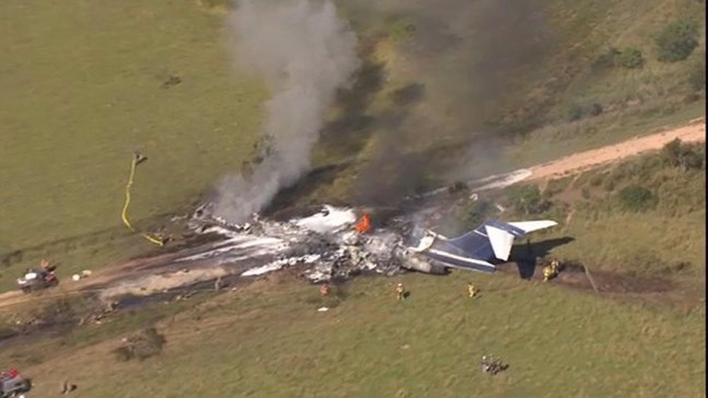 US plane with 21 people onboard crashes in Houston