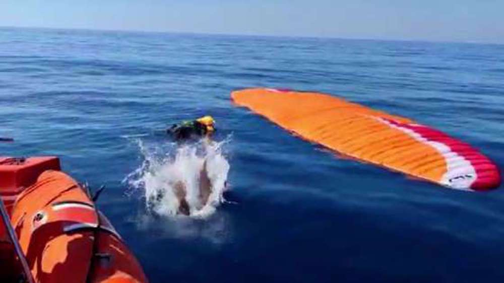Video shows terrifying moment of paragliders colliding in mid-air