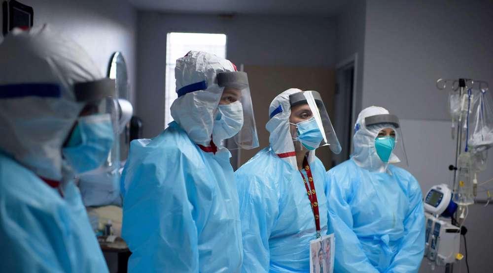 Skeptical US hospital workers choose dismissal over vaccine