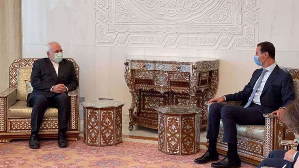 Meeting Assad, Zarif voices Iran's support for Syria presidential election