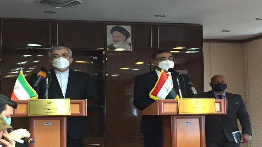 Iran to use funds held in Iraq to buy Russian COVID-19 vaccine, says minister