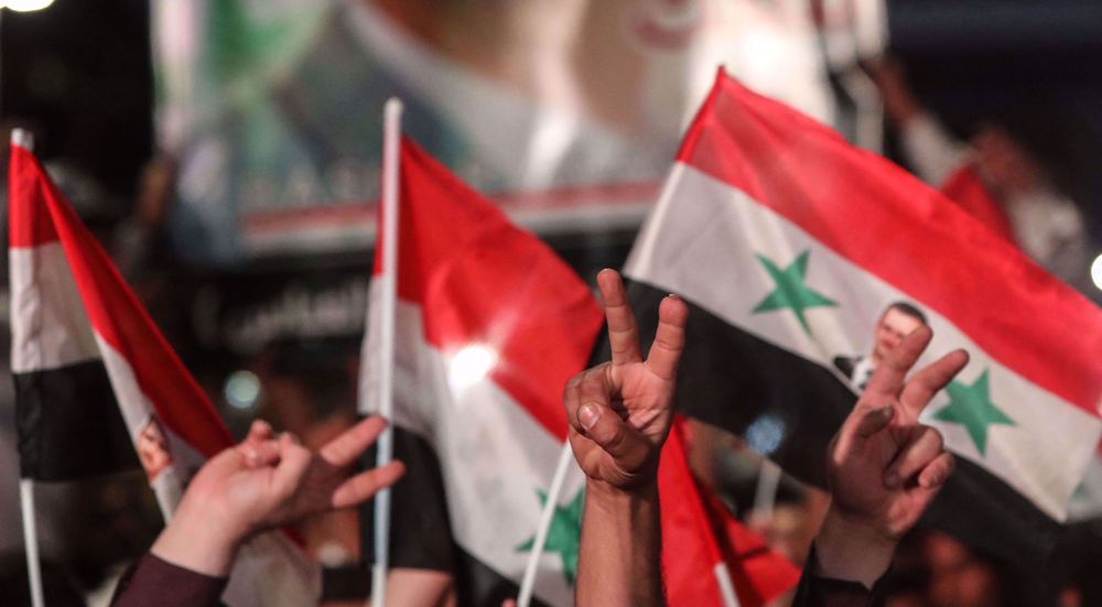 Syrians celebrate victory over opponents of election with high turnout