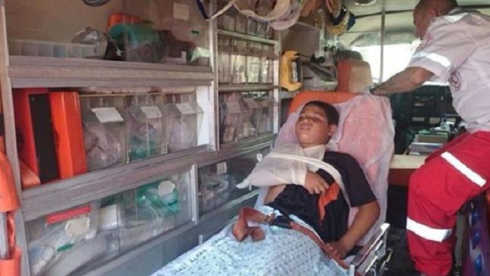 Israeli forces run over Palestinian child for carrying Palestine flag