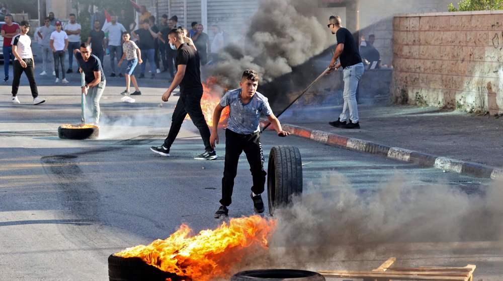 Palestinians protest against flag march in East Jerusalem al-Quds