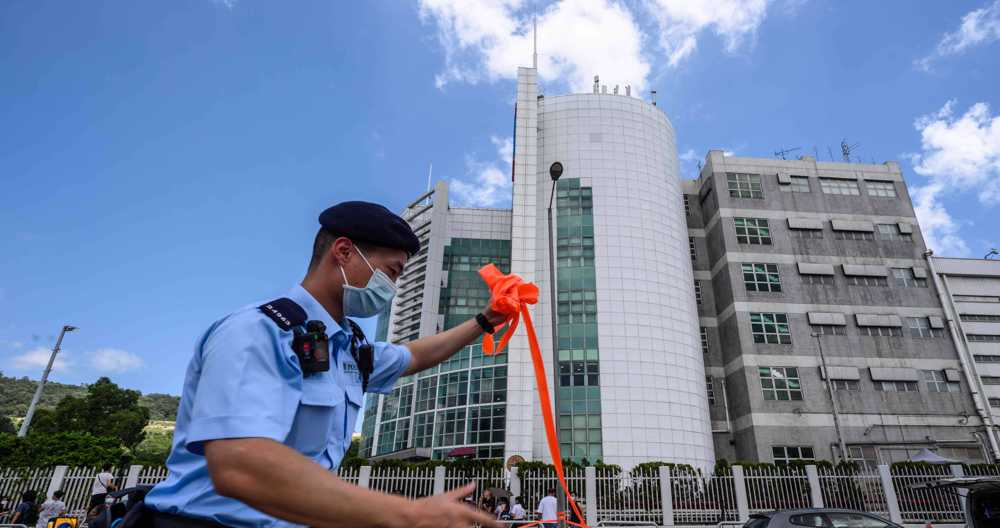Hong Kong police arrest paper's executives over 'suspected collusion with foreign forces'