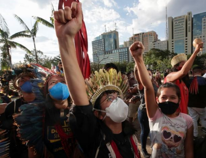 Hundreds of indigenous Brazilians protest bill curtailing land rights