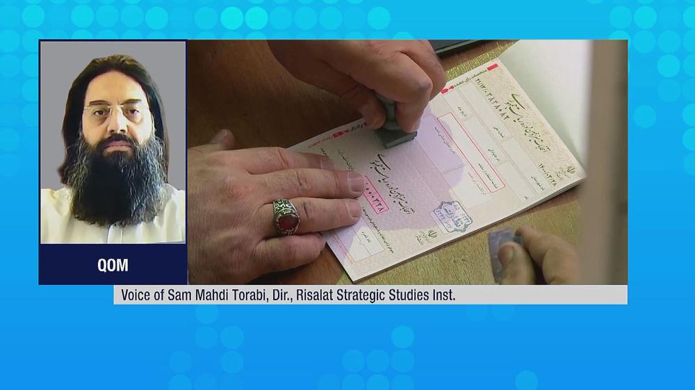 Press TV talks to Sam Mahdi Torabi on outcome of Iran presidential election