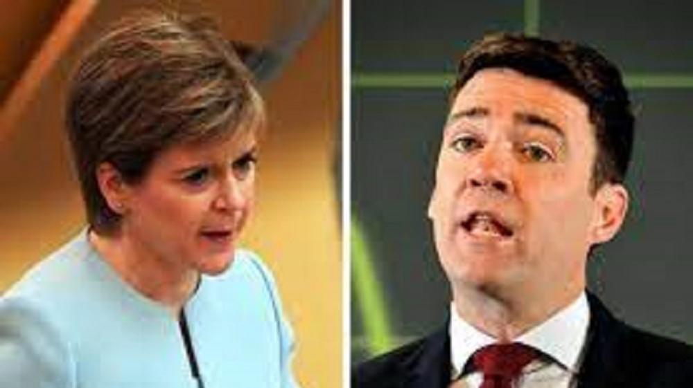 Burnham and Sturgeon clash over Covid travel ban