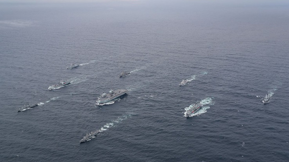 Royal Navy carrier strike group heading for South China Sea struck by Covid-19 outbreak