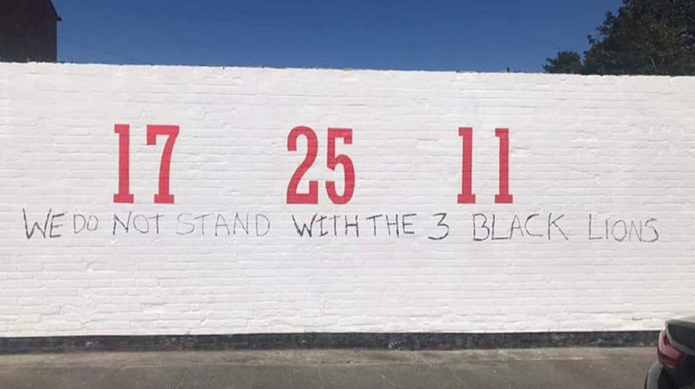 Mural dedicated to black players defaced with racist graffiti