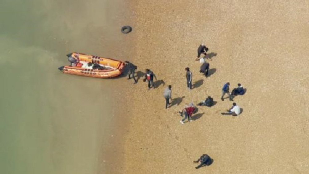 Record number of migrants cross English Channel as Patel vows to jail asylum seekers
