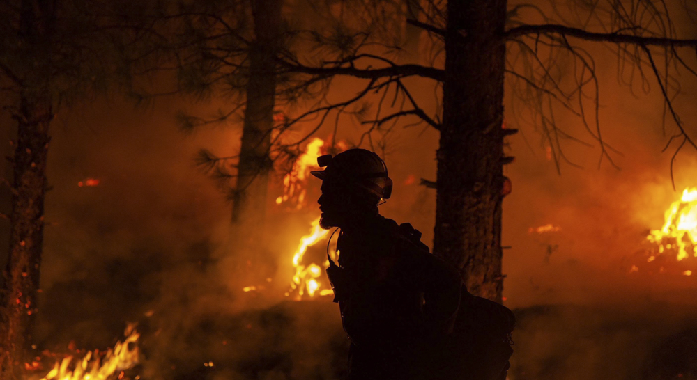 Blaze defies US firefighters, power firm under scrutiny