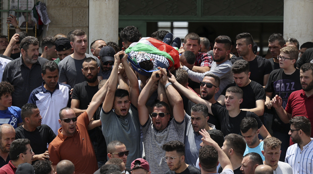 Palestinians hold funeral for 17-year-old shot by Israeli troops