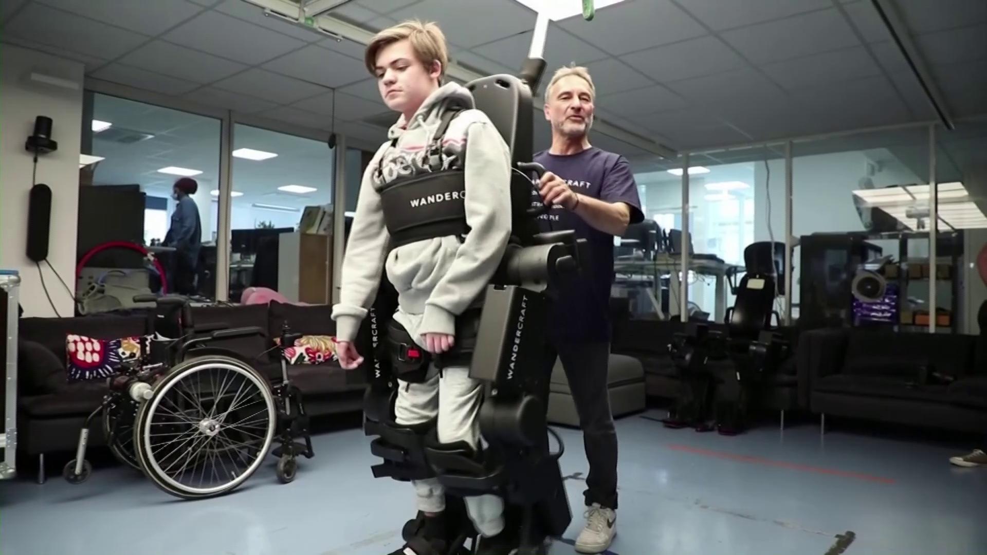 Father builds exoskeleton to help wheelchair-bound son walk
