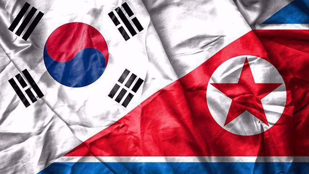 North, South Korea restore severed hotline