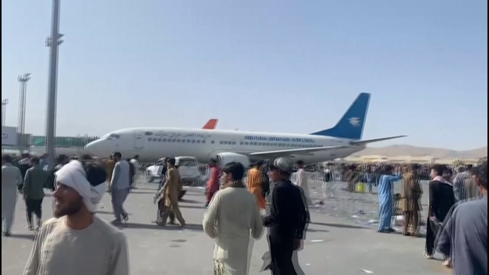 Desperate Afghans crowd Kabul airport apron to flee Taliban