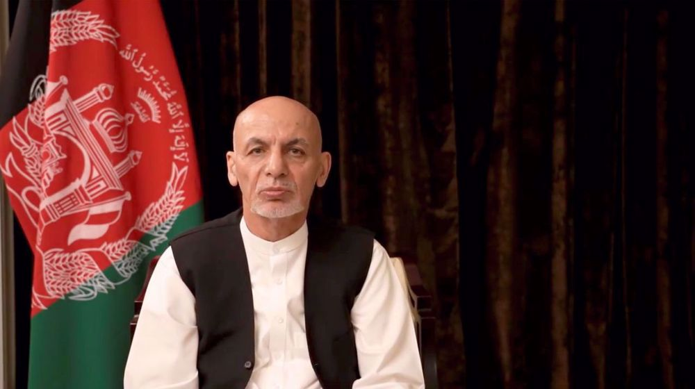 Afghanistan's runaway ex-president vows to return, denies he stole cash