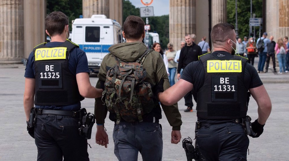 Hundreds arrested in Berlin as COVID skeptics scuffle with police