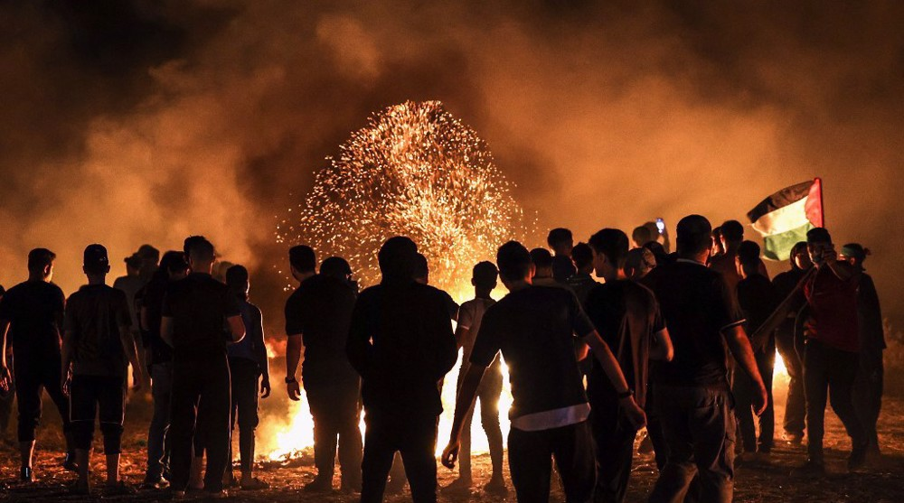 Gazans burn tires near fence for 2nd night to protest Israeli siege