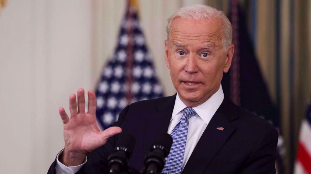 Biden blasts his administration's treatment of migrants