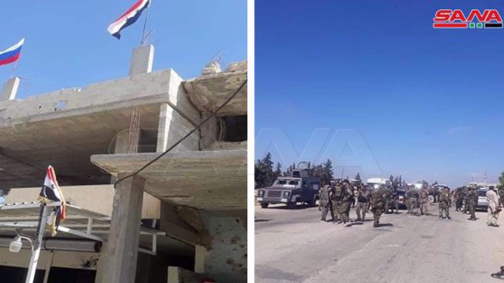 Syrian Army units enter Dara'a al-Balad, raise national flags