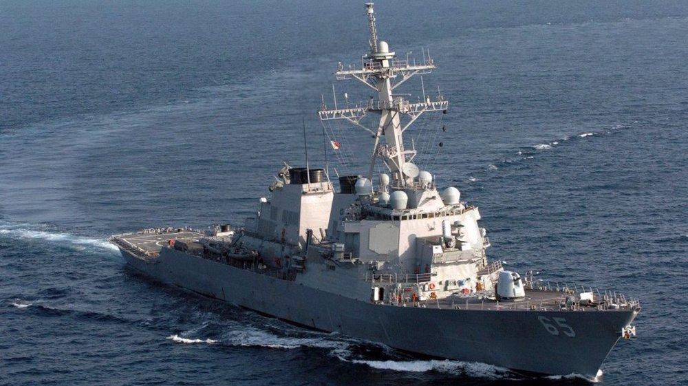 China warns off US warship sailing close to Spratly islands
