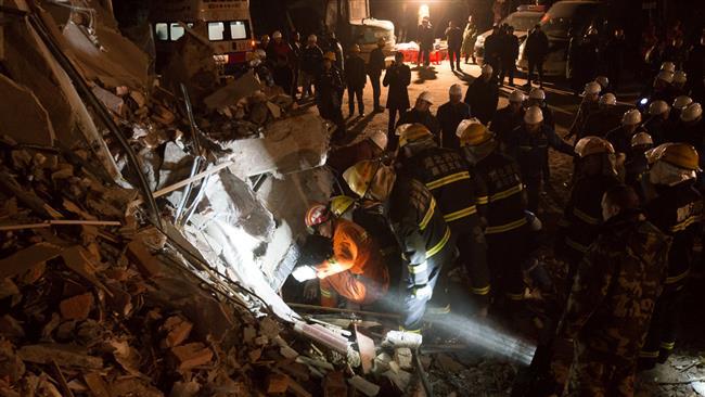 Two killed, 10 missing in central China landslide