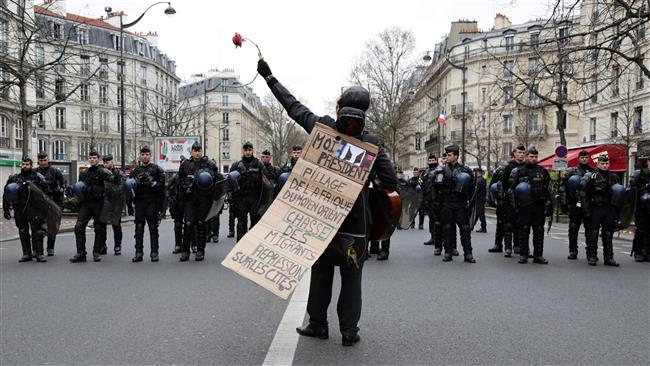 French protest police brutality in Paris
