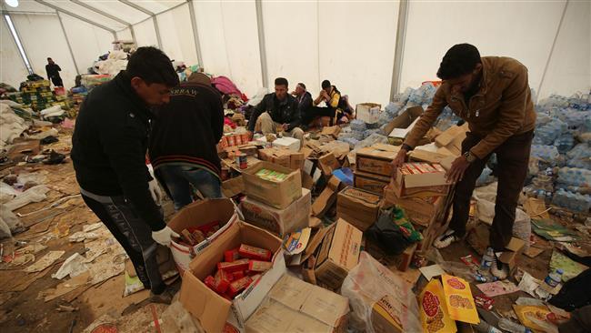 Hashd al-Sha'abi sends aid to liberated Mosul areas