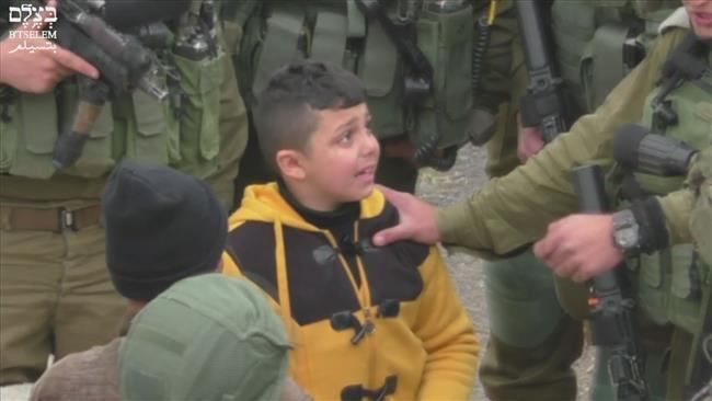 Israel troops grill terrified Palestinian kid: Video