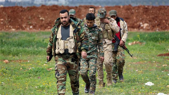 Syrian forces retake strategic town in Hama