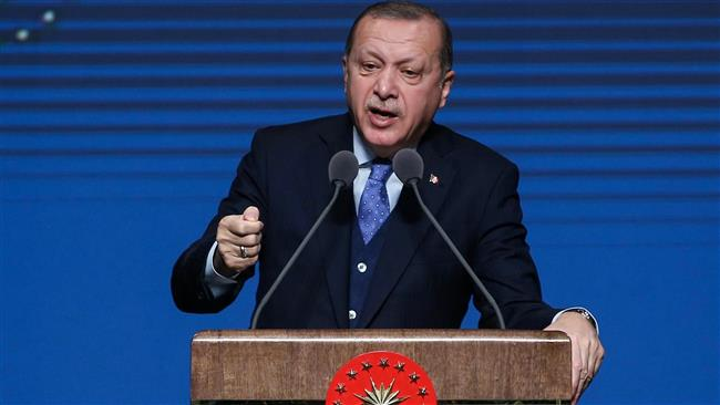 Turkey says will foil border 'games' amid Syria offensive