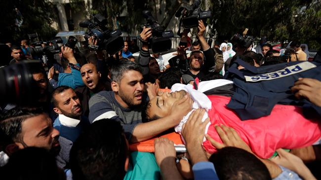 Funeral held for Palestinian journo killed in protests