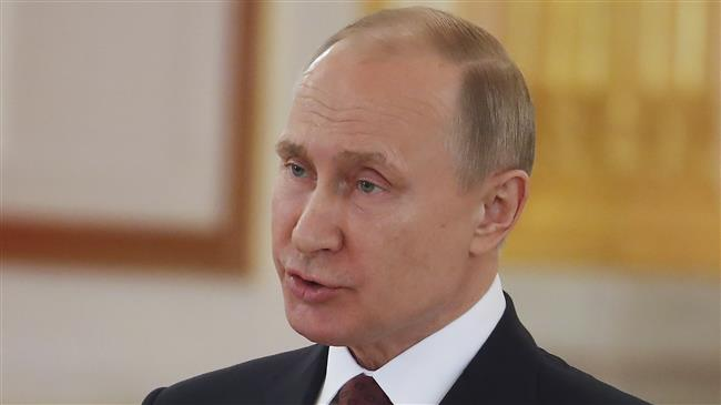 Putin warns France against any 'dangerous' Syria move