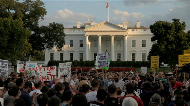 Protesters slam Trump: 'Gangster in White House'