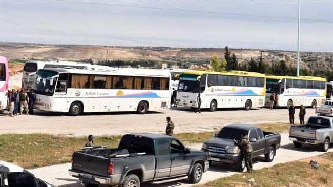 Militants leaving last strongholds in Syria's Homs, Hama