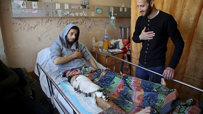 Gaza hospitals striving to treat influx of wounded