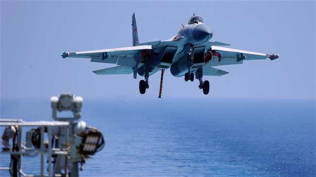 China army showcases night landing ops on carrier