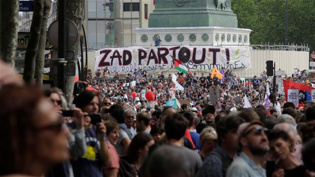 In France, 1000s protest against Macron's reforms