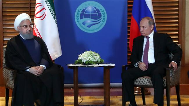 Rouhani: Russia key to JCPOA survival; Putin vows support